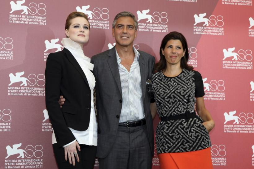 "U.S. actor Clooney, Wood and Tomei pose during a photocall for the film ""The Ides of March"" at the 68th Venice Film Festival in Venice"