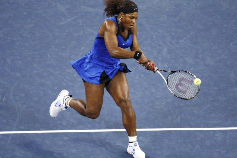 Serena Williams of the U.S. comes to the net against Bojana Jovanovski of Serbia during their match at the U.S. Open tennis tournament in New York