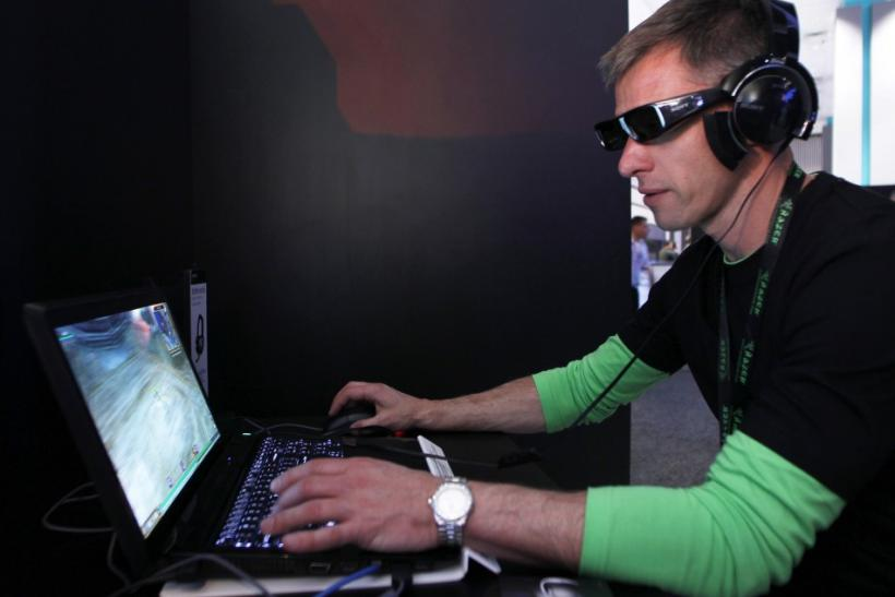 An attendee plays Everquest in 3-D wearing Sony's 3-D glasses and PC gaming audio headset during the Electronic Entertainment Expo or E3 in Los Angeles