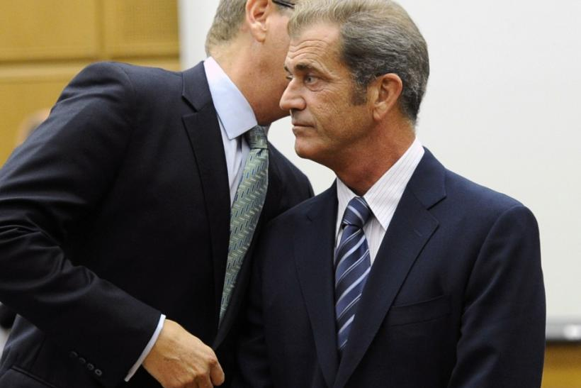 Actor Mel Gibson listens to his attorney Larry Ginsberg (L) during a hearing in Los Angeles Superior Court to finalize financial issues in a custody battle with former girlfriend Oksana Grigorieva In Los Angeles