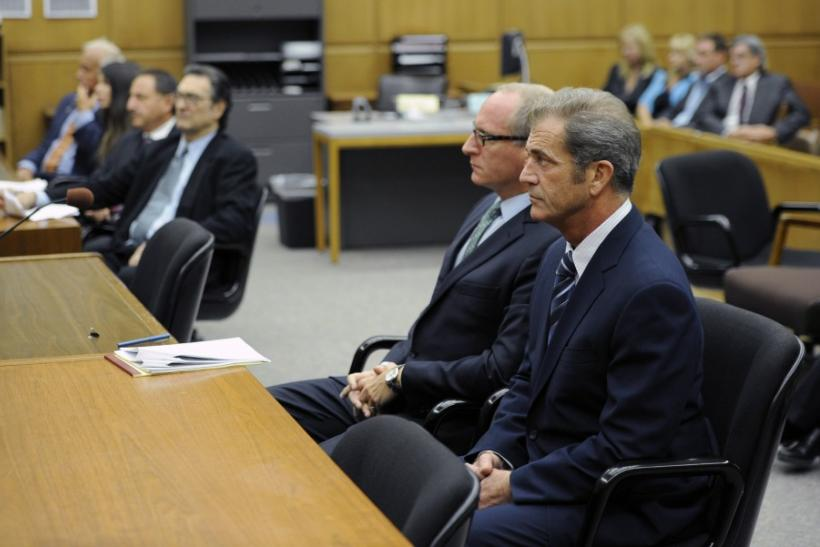 Actor Mel Gibson attends a hearing with his attorney Larry Ginsberg (2nd R) in Los Angeles Superior Court to finalize financial issues in a custody battle with former girlfriend Oksana Grigorieva In Los Angeles