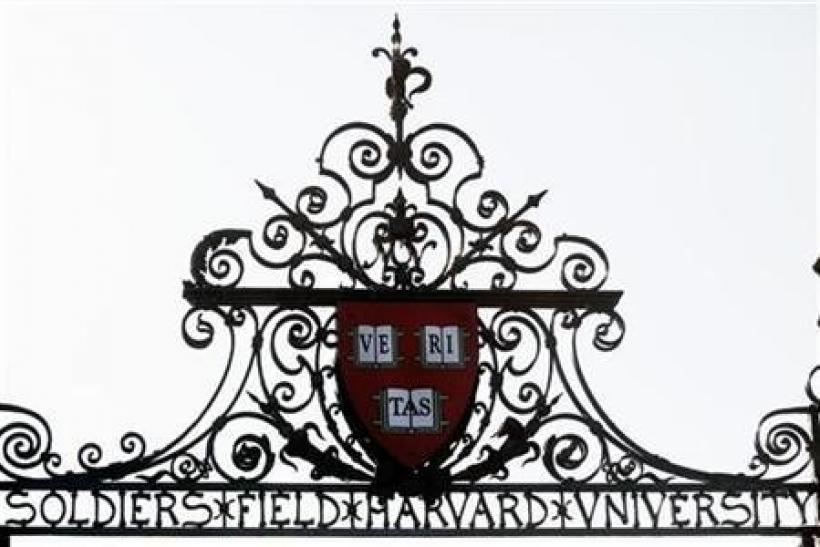 Harvard's seal sits atop a gate to the athletic fields at Harvard University in Cambridge, Massachusetts