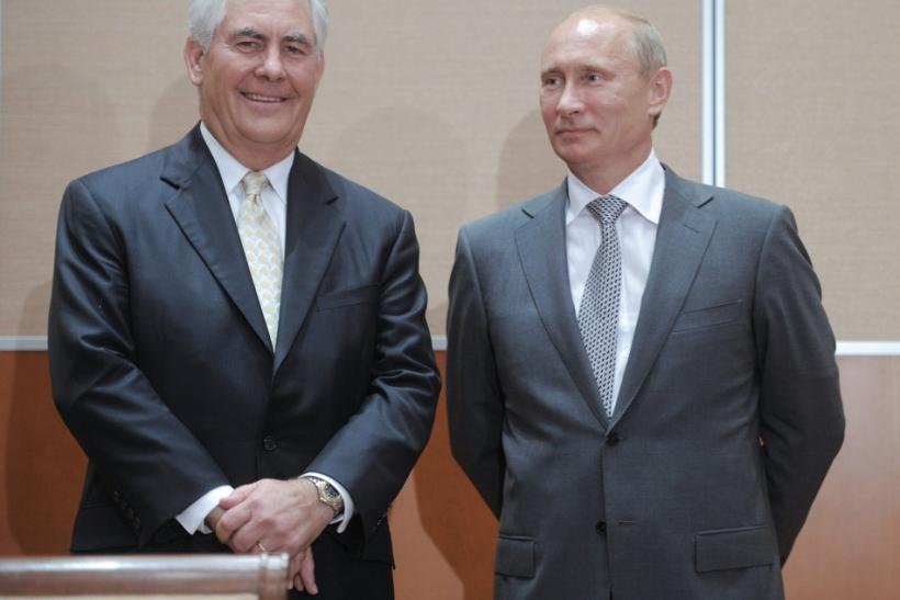 Russian Prime Minister Putin and Exxon CEO Tillerson look on at a signing ceremony in the Black Sea resort of Sochi