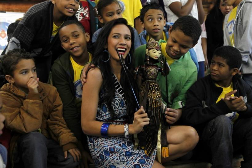 Miss Indonesia Nadine Alexandra poses with children at the Alianca Misericordia non-profit Catholic organisation in the outskirts of Sao Paulo