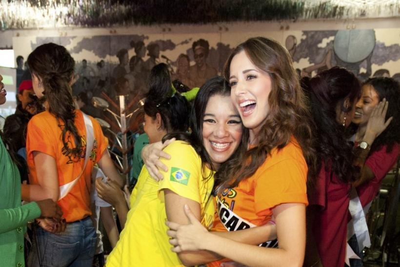 Miss Nicaragua Adriana Dom hugs a girl after joining dancers in a performance at Meninos do Morumbi social project in Sao Paulo