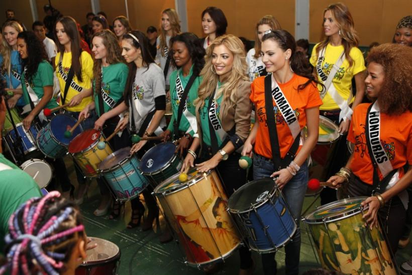 Miss Universe 2011 contestants attend a samba drums music class at Meninos do Morumbi non-governmental organization in Sao Paulo