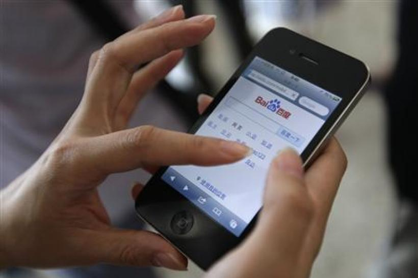 A user loads the Baidu homepage on her Apple iPhone 4 during the Baidu 2011 technology innovation conference in Beijing