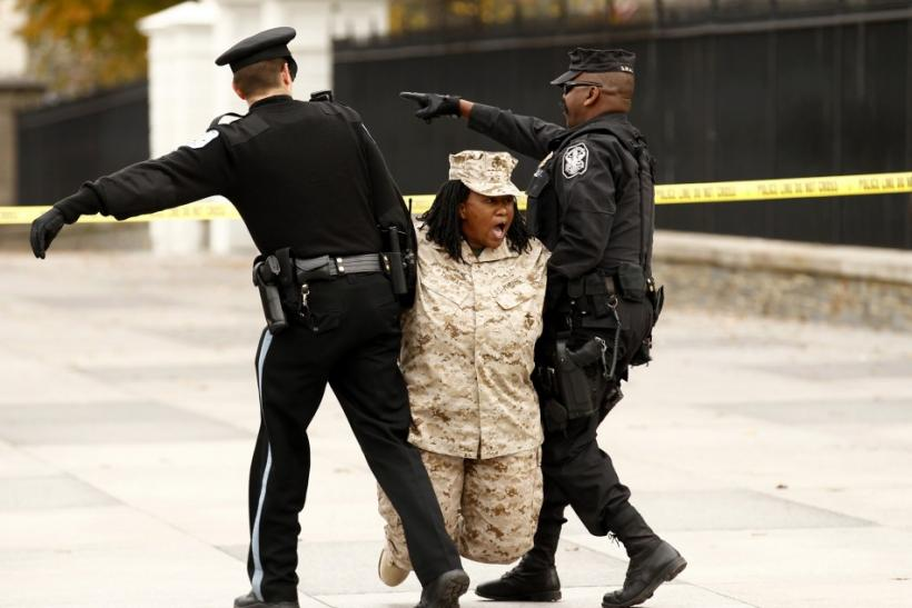 Veteran Evelyn Thomas is arrested after handcuffing herself to a fence at the White House in Washington