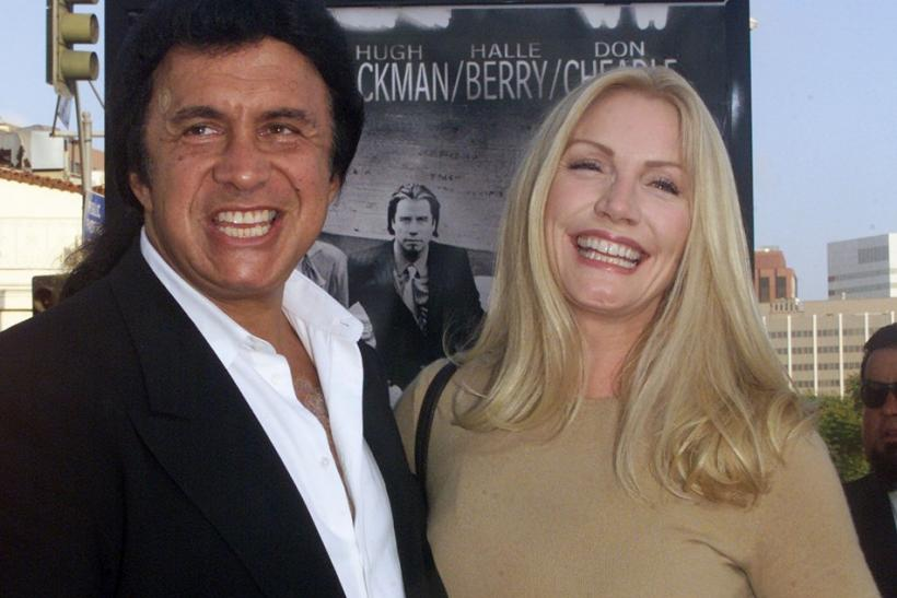 "Gene Simmons of the rock group ""KISS"" and Shannon Tweed arrive as guests for the premiere of the new action drama film ""Swordfish"" in Los Angeles June 4, 2001."