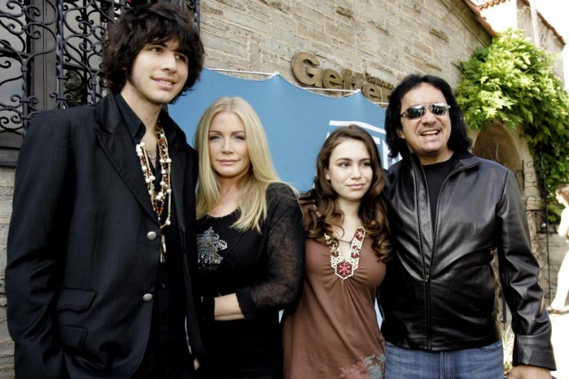 Music recording artist Gene Simmons (R) poses with his long time partner Shannon Tweed (2nd-L) and their two children, Nicholas and Sophie, at the A&E networks up-front presentation at the Geffen Playhouse in Los Angeles May 5, 2006.