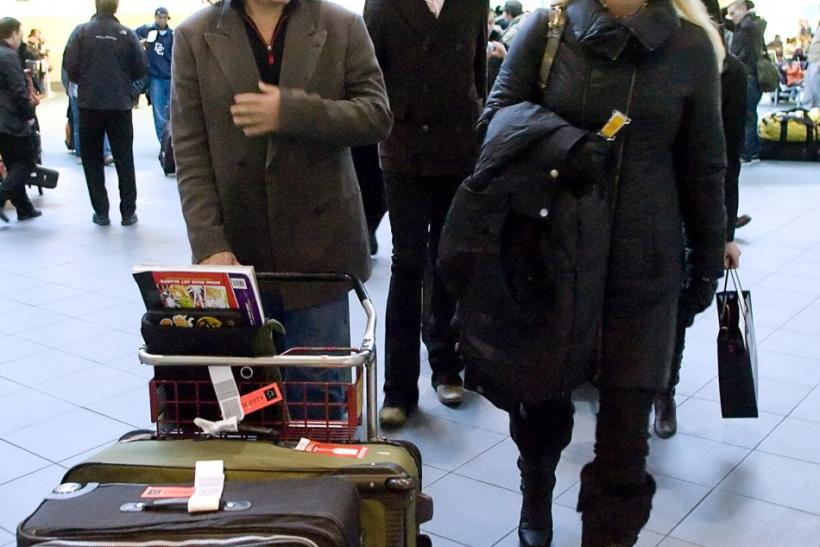 Rock Star Gene Simmons (L) accompanied his partner Shannon Tweed (R) and son Nick arrive in Vancouver, British Columbia December 29, 2008. The family were heading to the ski resort of Whistler.