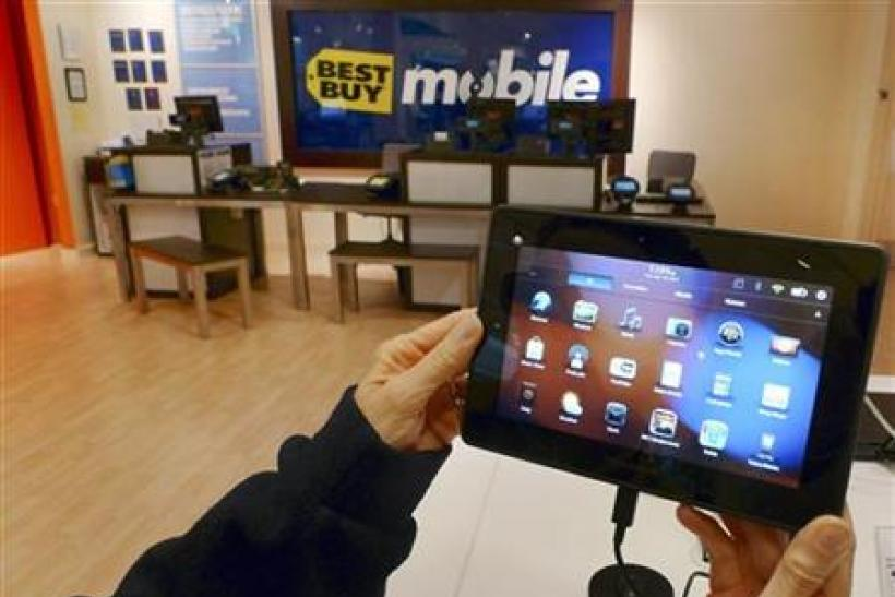 A customer holds a Research In Motion's PlayBook tablet computer in Fairfax
