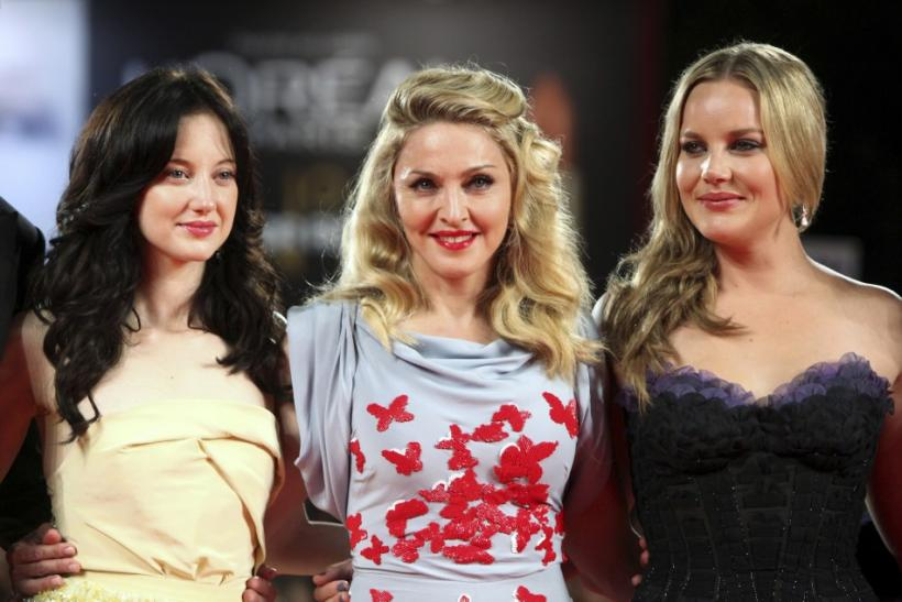 "Madonna poses with actresses Riseborough and Cornish on the ""W.E"" red carpet at the 68th Venice Film Festival"