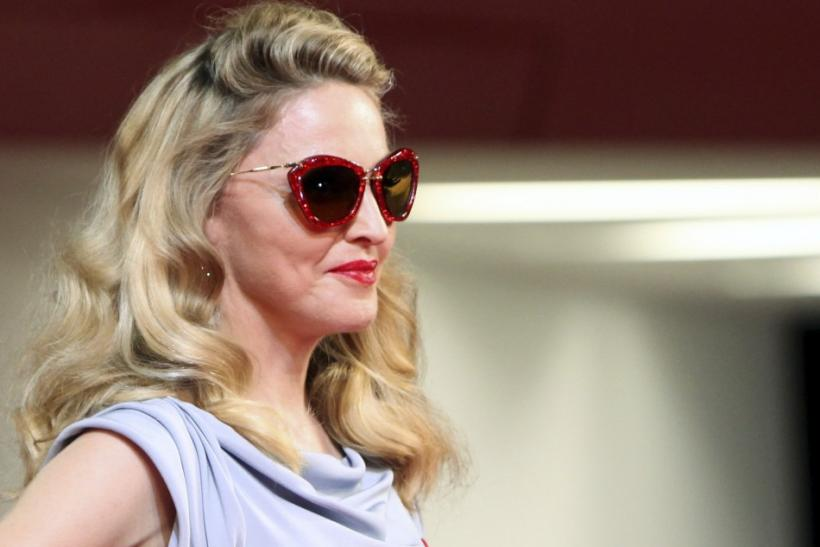 "Madonna poses for photographers on the ""W.E"" red carpet at the 68th Venice Film Festival"