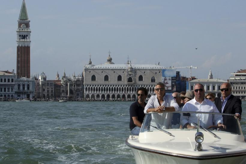 U.S. actor George Clooney (2nd L) arrives by speedboat in Venice