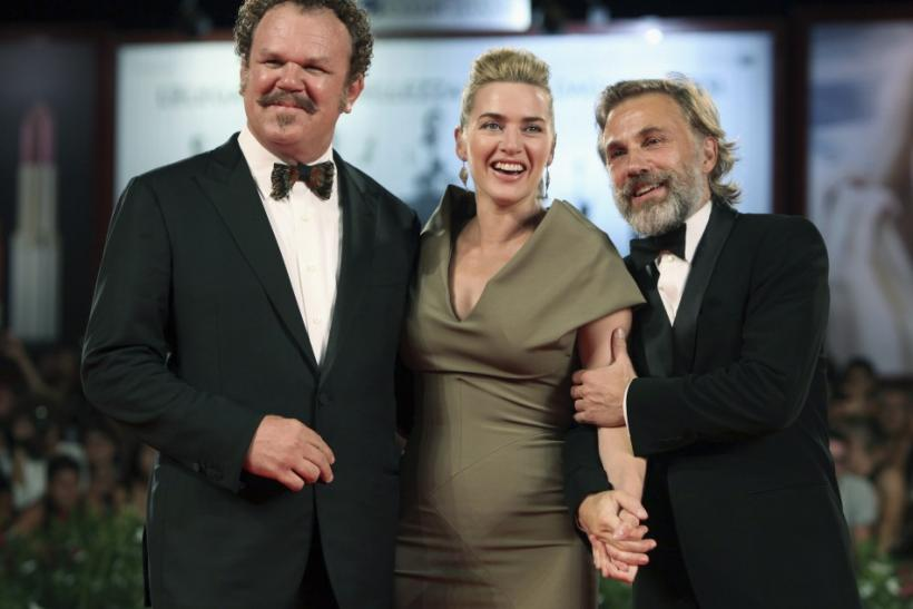 "Actors Kate Winslet (C), John C. Reilly (L) and Christoph Waltz pose for photographers as they arrive on the ""Carnage"" red carpet at the 68th Venice Film Festival in Venice"
