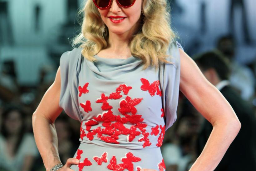 "U.S. pop star and director Madonna poses for photographers as she arrives on the ""W.E"" red carpet at the 68th Venice Film Festival in Venice"