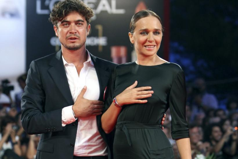 "Actors Riccardo Scamarcio (L) and Valeria Golino pose for photographers on the ""Carnage"" red carpet at the 68th Venice Film Festival in Venice"