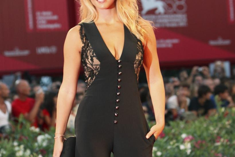 "Model Bar Refaeli poses for photographers on the ""Carnage"" red carpet at the 68th Venice Film Festival in Venice"