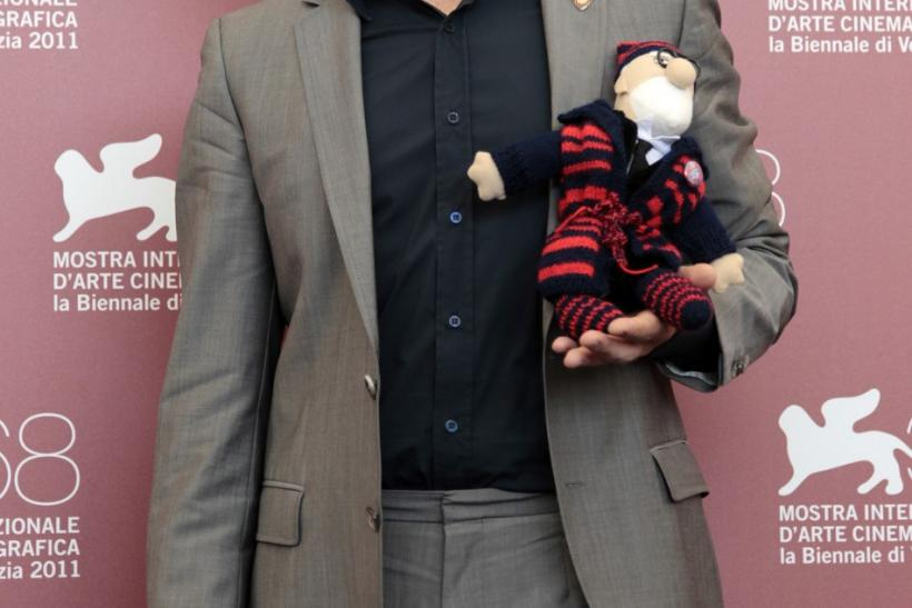 "Actor Viggo Mortensen holds a cuddly toy received from his fan during a photocall for his film ""A Dangerous Method"" at the 68th Venice Film Festival"