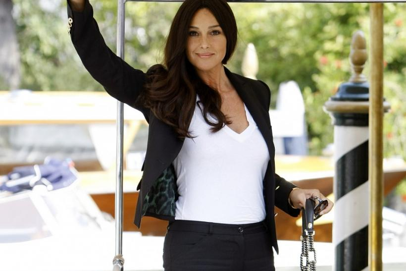 "Actress Monica Bellucci waves as she arrives prior to a news conference for her film ""Un Ete Brulant"" at the 68th Venice Film Festival"