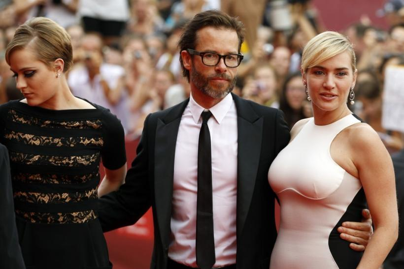 "Actress Kate Winslet arrives with Guy Pearce (C) and Evan Rachel Wood (L) during a red carpet of their TV miniseries ""Mildred Pierce"" by director Todd Haynes at the Film Cinema's Place at the 68th Venice Film Festival"