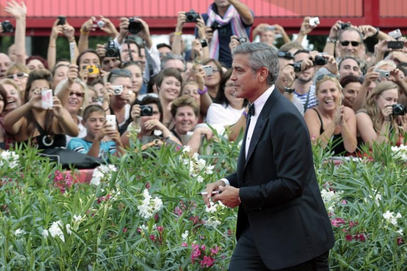 "U.S. actor George Clooney arrives on the ""The Ides of March"" red carpet at the 68th Venice Film Festival in Venice"