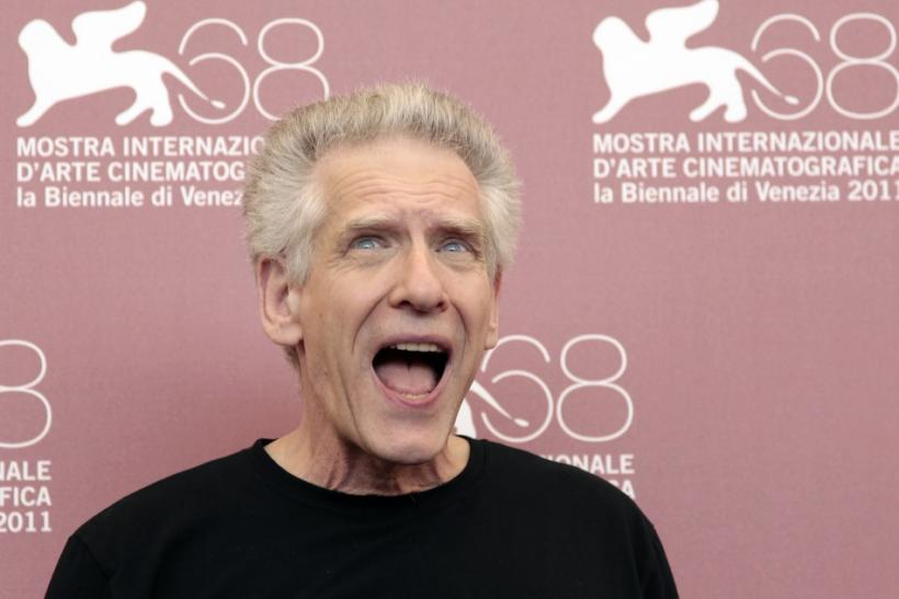 "Director David Cronenberg reacts as he poses during a photocall for his film ""A Dangerous Method"" at the 68th Venice Film Festival"