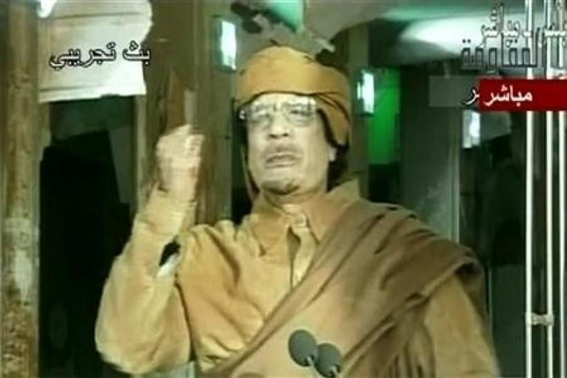 Libyans pledge democracy as they win Gaddafi billions