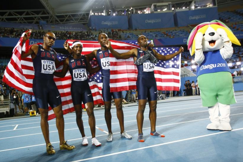 US team celebrates after winning the men's 4x400 metres relay final at the IAAF World Championships in Daegu