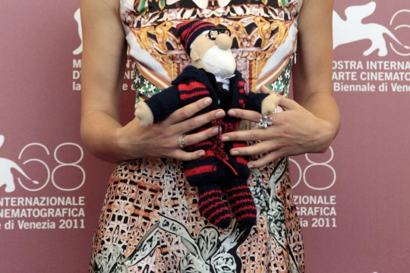 "Actress Knightley holds toy given to her by co-star Mortensen at a photocall for their film ""A Dangerous Method"" which is in competition at the 68th Venice Film Festival"