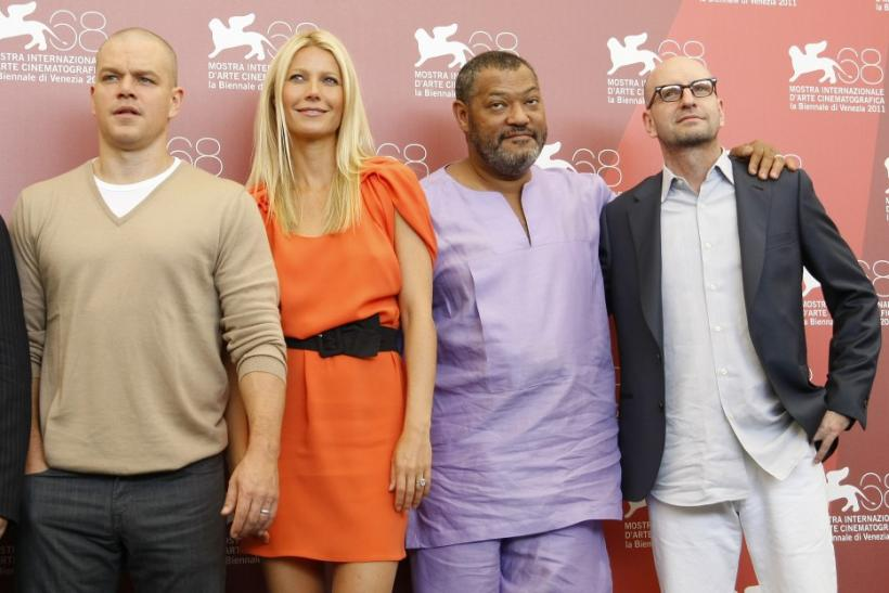 "Soderbergh poses with Damon, Paltrow, Fishburne during a photocall of their film ""Contagion"" at the 68th Venice Film Festival"