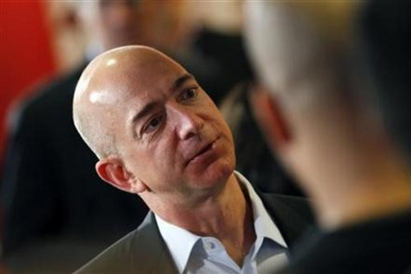 Amazon.com President, Chief Executive and Chairman Jeffrey Bezos speaks with employers and attendees at the Consumer Reports headquarters in Yonkers, New York.
