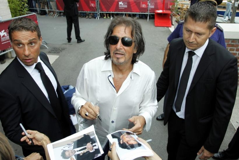 "Director and actor Al Pacino signs autographs as he leaves after a news conference of his film ""Wilde Salome"" at the 68th Venice Film Festival"