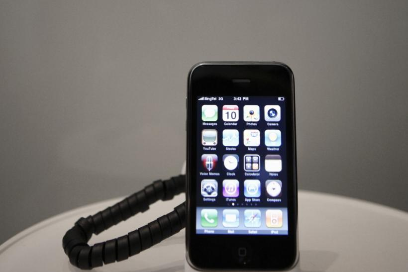 An Apple iPhone 3GS sits on a cradle at a Singtel showroom ahead of the phone launch this evening in Singapore 10/07/2009