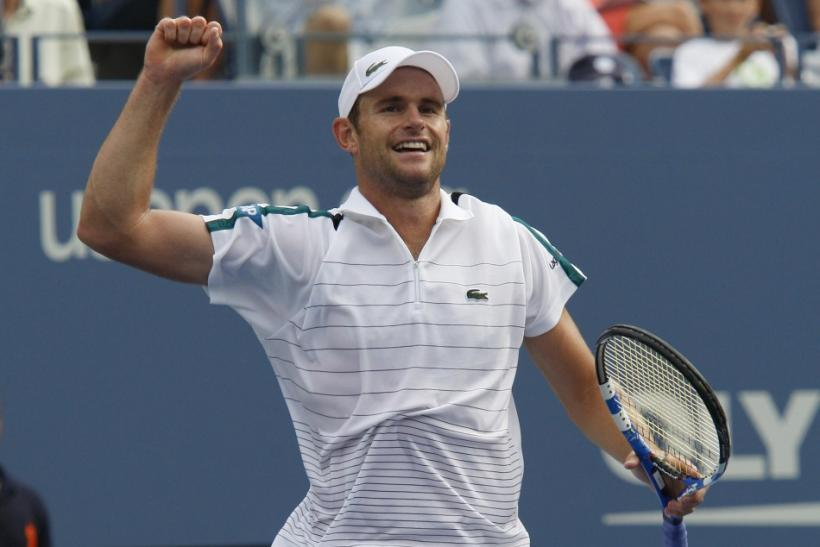 Andy Roddick of the U.S. celebrates his win over Julien Benneteau of France during their match at the U.S. Open tennis tournament in New York
