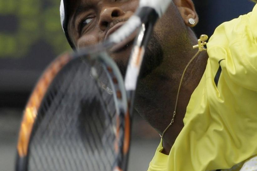 Donald Young of the U.S. serves to Stanislas Wawrinka of Switzerland during their match at the U.S. Open tennis tournament in New York