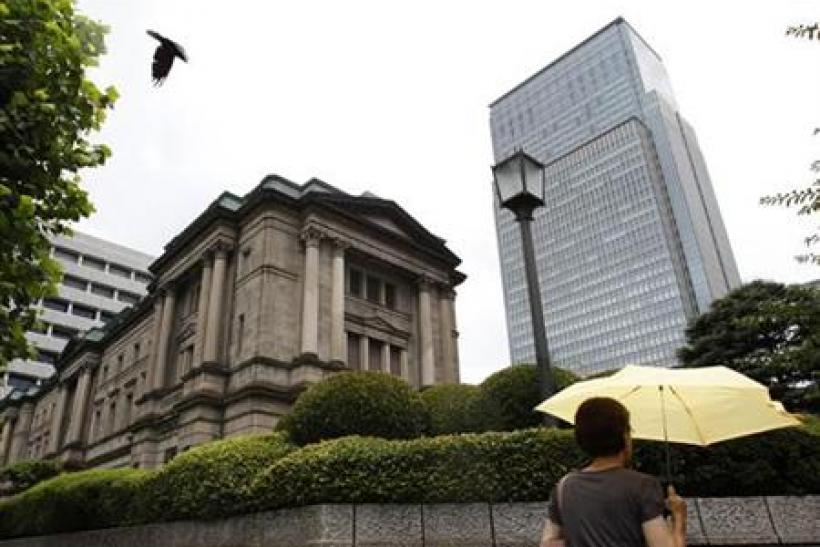 A crow flies near the Bank of Japan headquarters building in Tokyo
