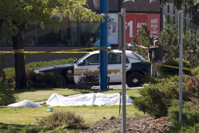 The body of a shooting victim covered with a sheet lies on the front lawn of an IHOP restaurant in Carson City, Nevada, as sheriffs secure the crime scene