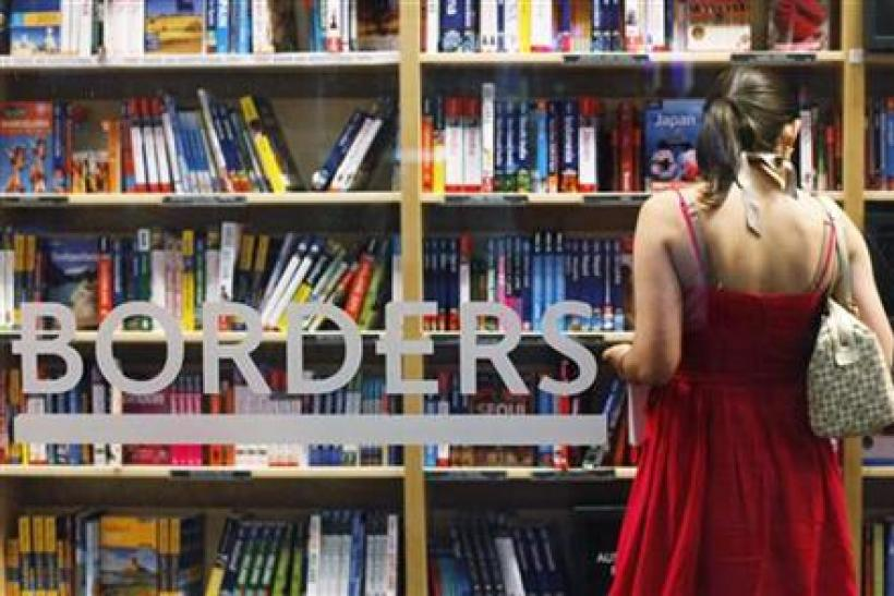 A woman shops inside a Borders bookstore in New York