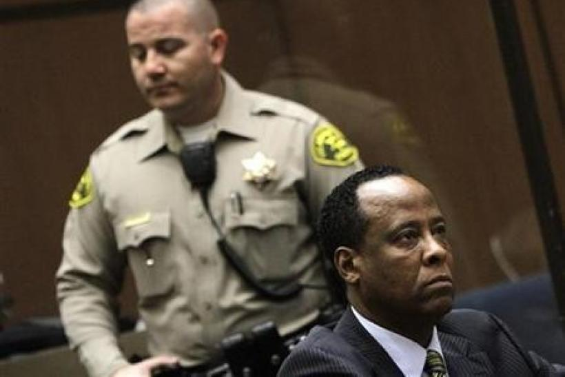 Doctor Conrad Murray, the late Michael Jackson's personal physician, listens during his arraignment on a charge of involuntary manslaughter in the pop star's death, in Los Angeles