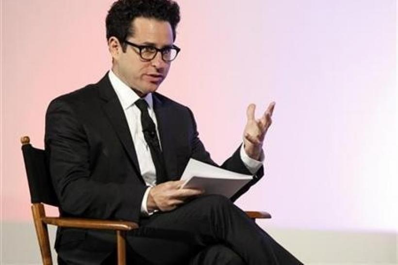 Director J.J. Abrams asks a question to U.S. first lady Michelle Obama (not pictured) at a Joining Forces event at the Writers Guild theatre in Beverly Hills, California