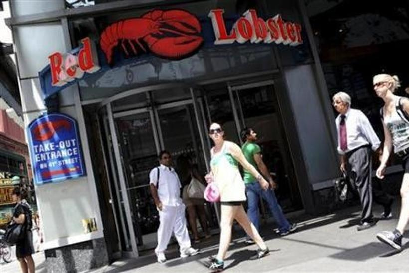 Passersby walk in front of the Times Square Red Lobster restaurant in New York