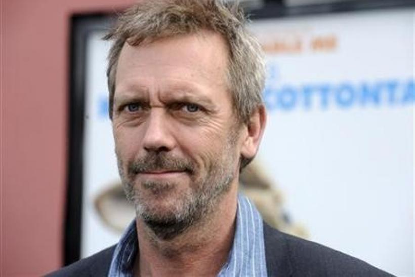 Cast member Hugh Laurie attends the premiere of the film ''Hop'' in Los Angeles