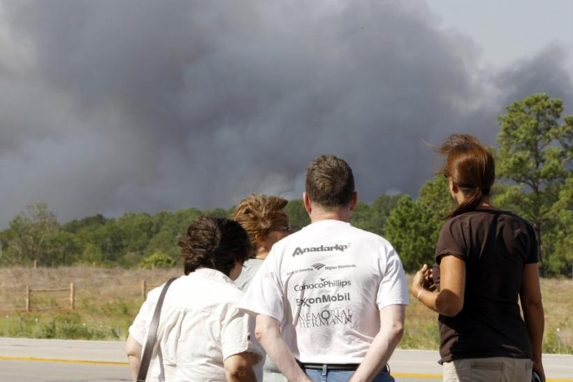 People watch as a wildfire burns out of control near Bastrop, Texas September 5, 2011.