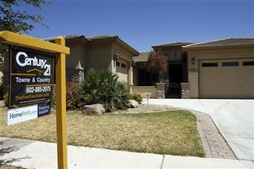 A real estate for sale sign is displayed outside a home in Chandler Heights, Arizona