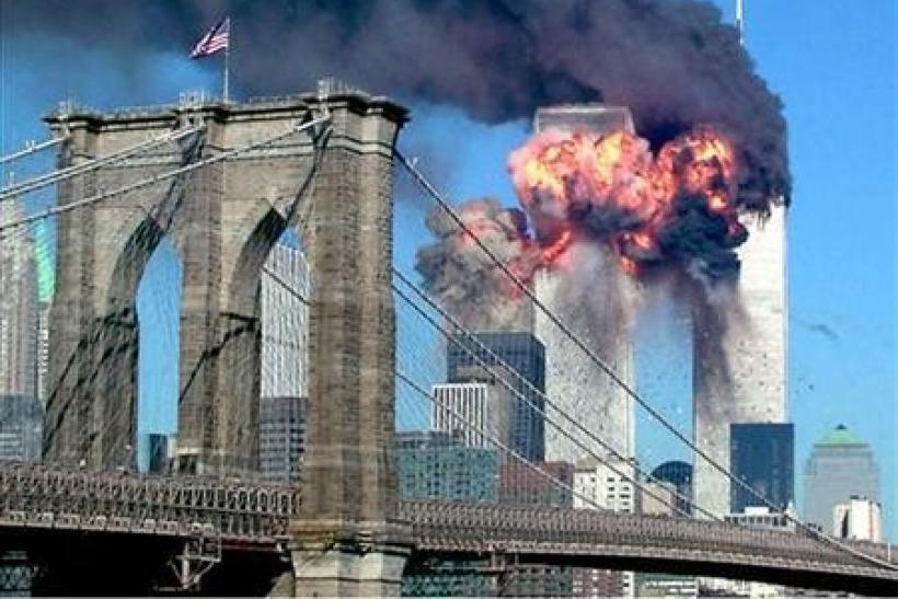 The second tower of the World Trade Center bursts into flames after being hit by a hijacked airplane in New York in this September 11, 2001 file photograph.