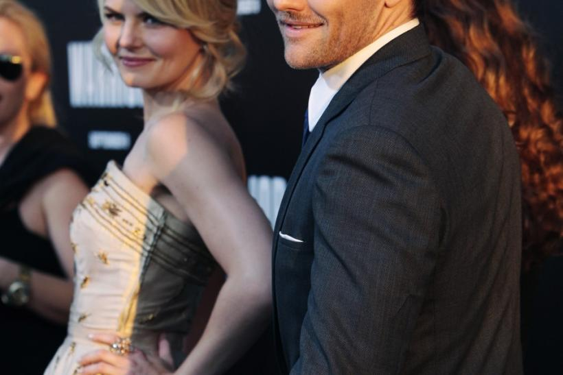 "Cast members Joel Edgerton (R) and Jennifer Morrison arrive at the film premiere of ""Warrior"" in Hollywood, California"