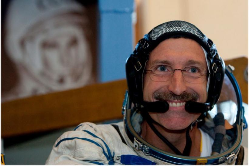 U.S. astronaut Daniel Burbank smiles after taking exams at the Star City space center
