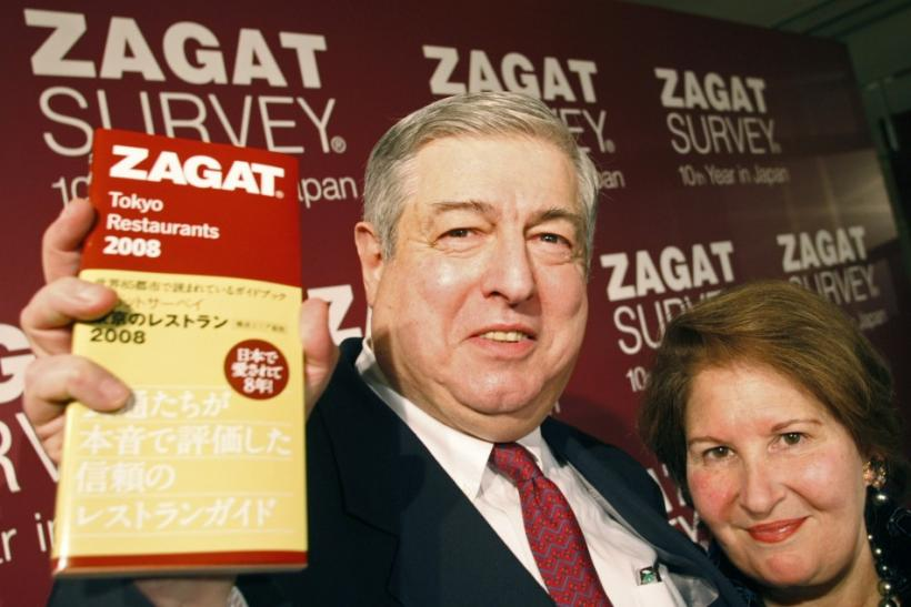 Zagat Survey co-founders Tim and Nina Zagat pose with the latest version of their guide to Tokyo restaurants at a news conference in Tokyo